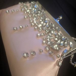 Pink satin heavily jeweled evening clutch.